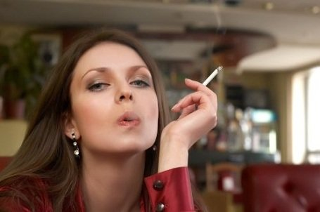 sesy green eyes brunete in red with smoking cigarette